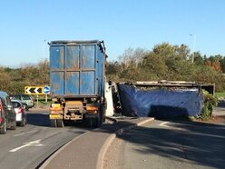 Traffic chaos as overturned lorry sheds garden waste on busy Cannock road