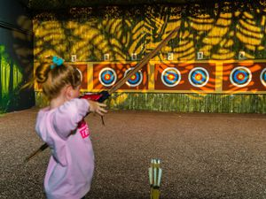 Taking part in Archery at Bear Grylls Adventure