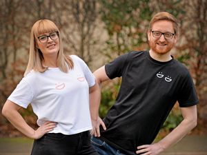 Emily Shaw modelling the T-shirts with Simon Hicks