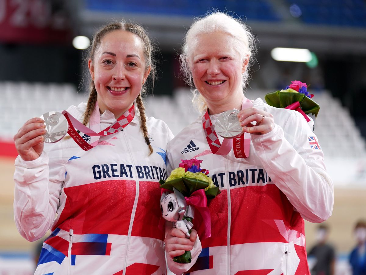 Tandem cyclists Aileen McGlynn, right, and pilot Helen Scott claimed Great Britain's maiden medal on day two of the Tokyo Games