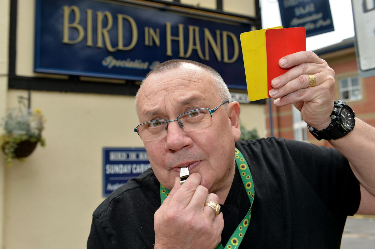 Landlord Terry Cope with cards and whistle. The Bird In Hand pub in Stafford has banned 150 drinkers since lockdown rules were eased through the Covid referee system