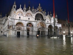 High tide causes widespread flooding in Venice