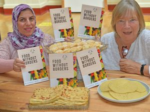 """Gill Kelly, from Wolverhampton City of Sanctuary has produced a cookbook called """"Food without borders"""", which she collected from migrants and asylum seekers working with the sanctuary and in association with the Refugee and Migrant centre. She is pictured with Hamia Boutarik who contributed to the book"""