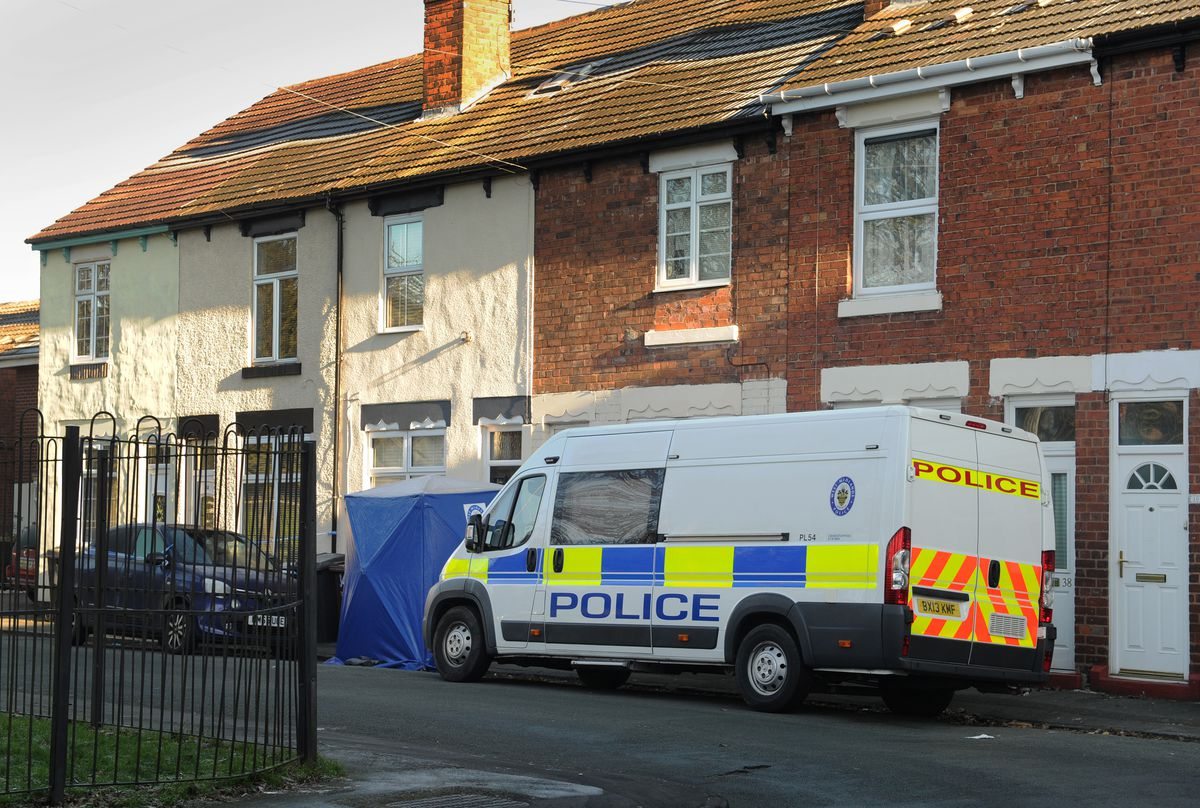 Neighbours spoke of their shock after the woman's body was discovered at a hose in James Street
