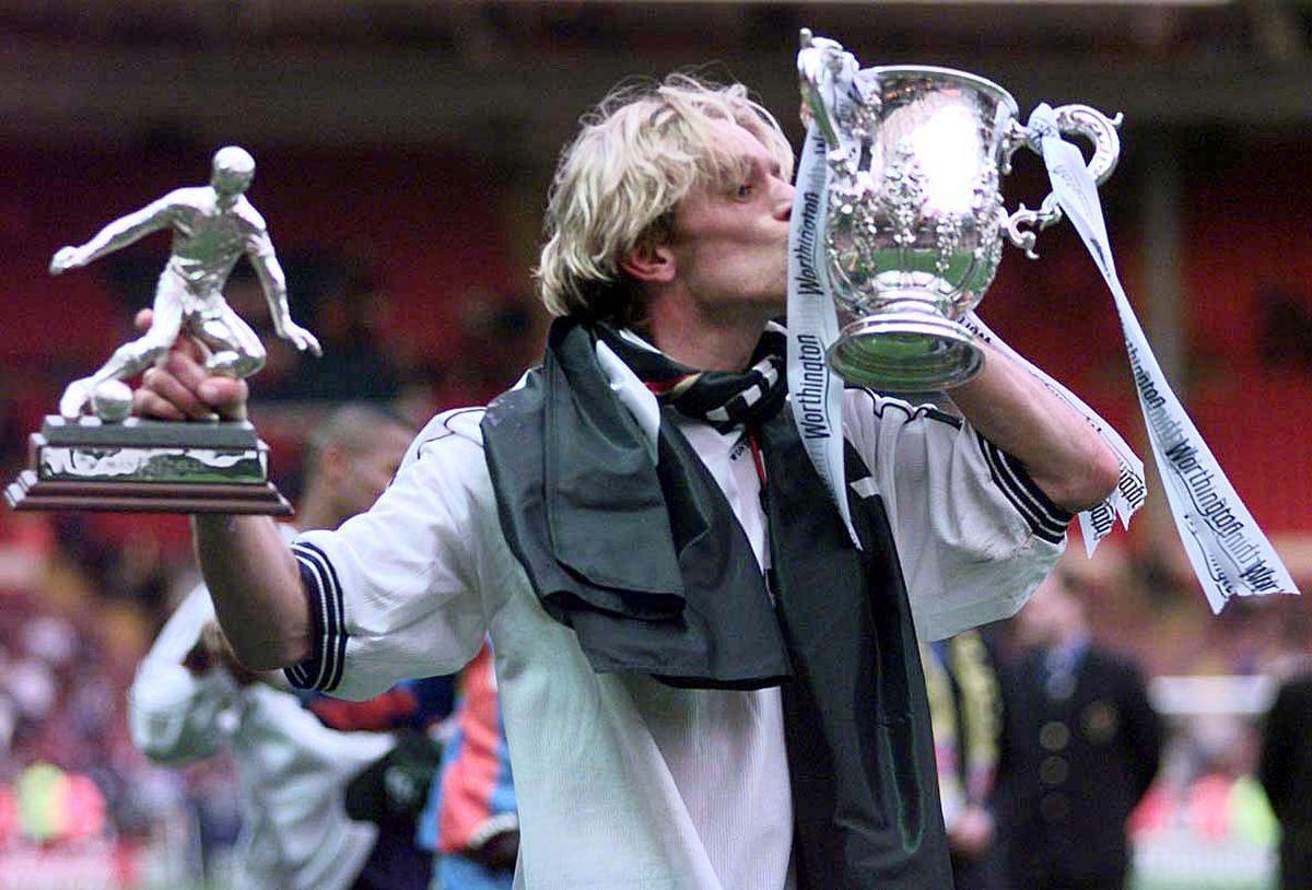 Tottenham Hotspur's Goal scorer, and man of the match Allan Nielsen celebrates at Wembley.