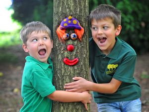 Bertie Binnian, aged 5, and brother Alfie, aged 8, enjoy the trail at Bodenham Arboretum as they look for the Tree People