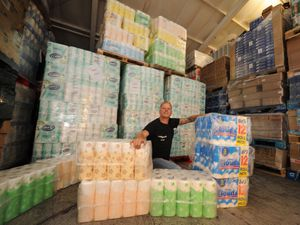 Looking at a mountain of toilet paper, as people have started buying more again, owner Glynn Goodsell, at Sellgoods Ltd, Tipton