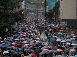 Police and protesters clash in Hong Kong following march