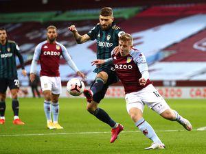 Aston Villa's Matt Targett (right) and Leeds United's Mateusz Klich