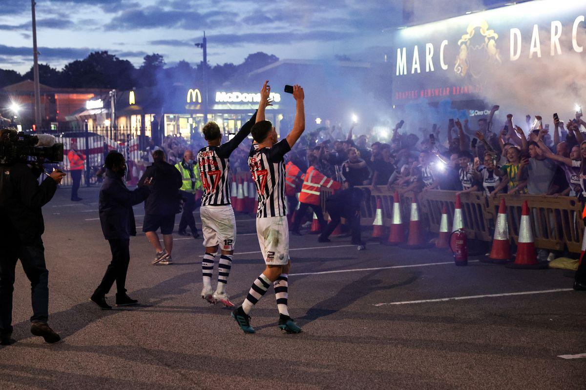 Dara O'Shea and Callum Robinson celebrate with the fans outside the stadium. Photo: AMA