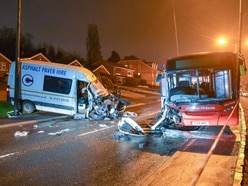 Van driver killed in rush-hour crash with bus