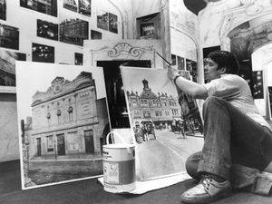 A member of staff prepares for the display titled 'Curtains' to mark the reopening of the Grand Theatre