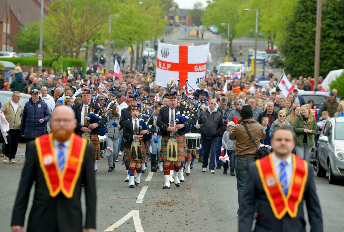 Crowds of people gathered for Stone Cross' St Georges Parade last year.