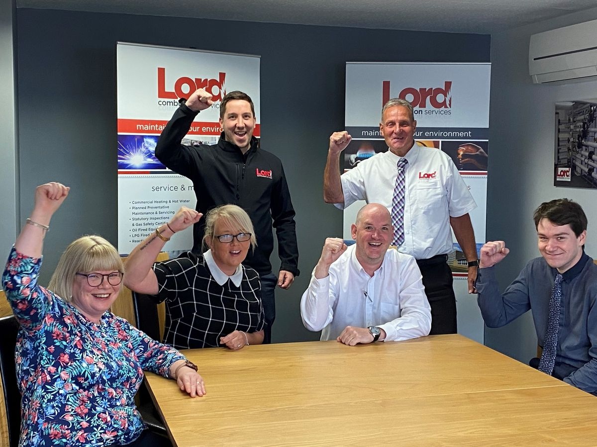 Lord Combustion Services directors Greg Jones and Mark Chapman celebrate their four H & V Awards finalist placings with from front left Jill Sidebottom, Suzanne Birch, Peter Drew and Matthew Smith