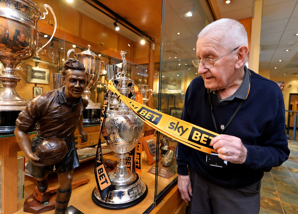 Historian Graham Hughes places Wolves' latest trophy, the 2017/18 Championship title, into the cabinet