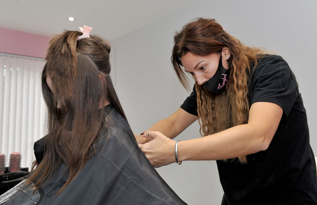 Stylist Faye Lawley in action cutting Mia's hair