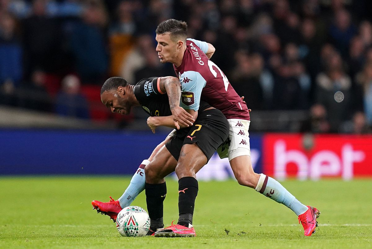 Manchester City's Raheem Sterling (left) and Aston Villa's Frederic Guilbert battle for the ball