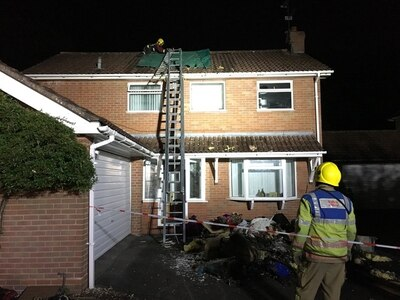 Residents flee fire which damages roof of home