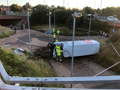 DPD driver arrested as van ends up near subway after roundabout crash