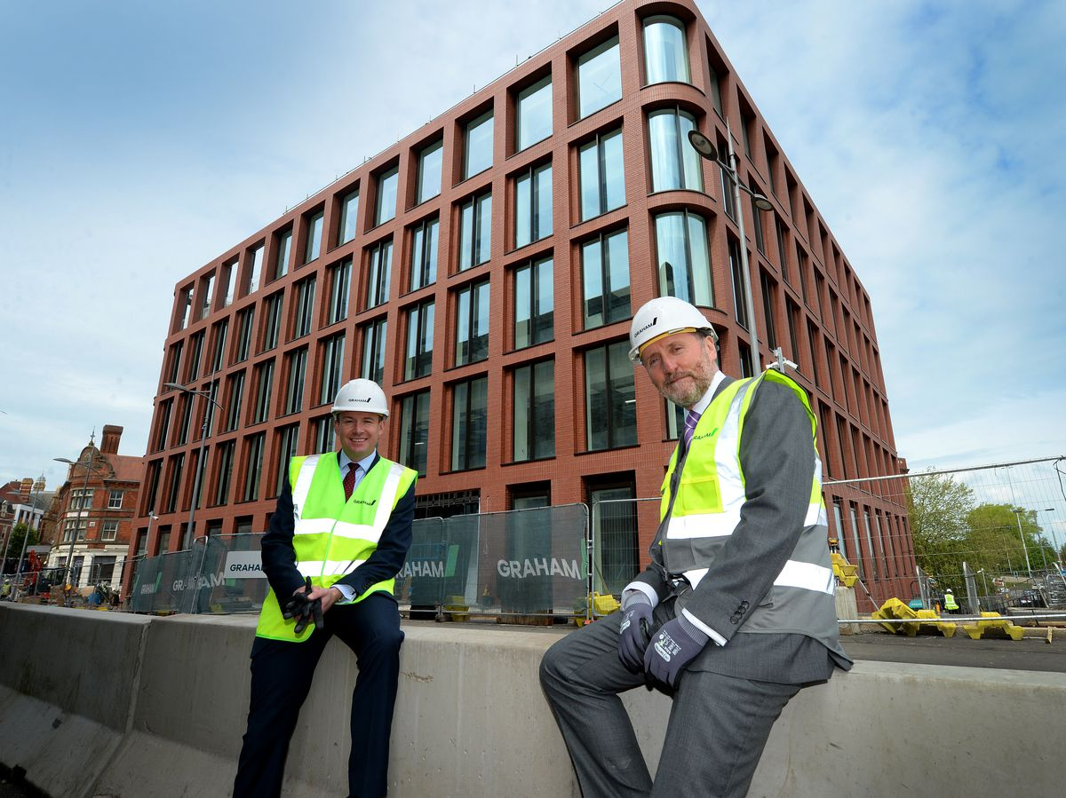 MPs Stuart Anderson and Eddie Hughes celebrate the new government offices in Wolverhampton