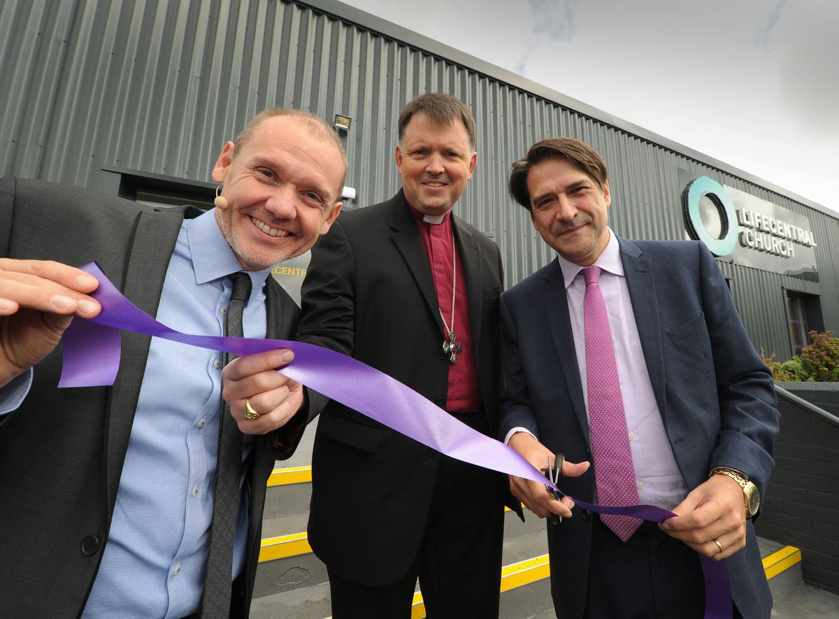Officially opening the LifeCentral Church new build, Halesowen, (right) James Morris MP, with (left-right) Reverend Leon Evans, lead pastor, and Bishop of Dudley Graham Usher.