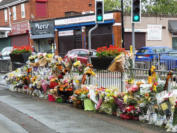 The tributes run along the railings outside the Clifton pub