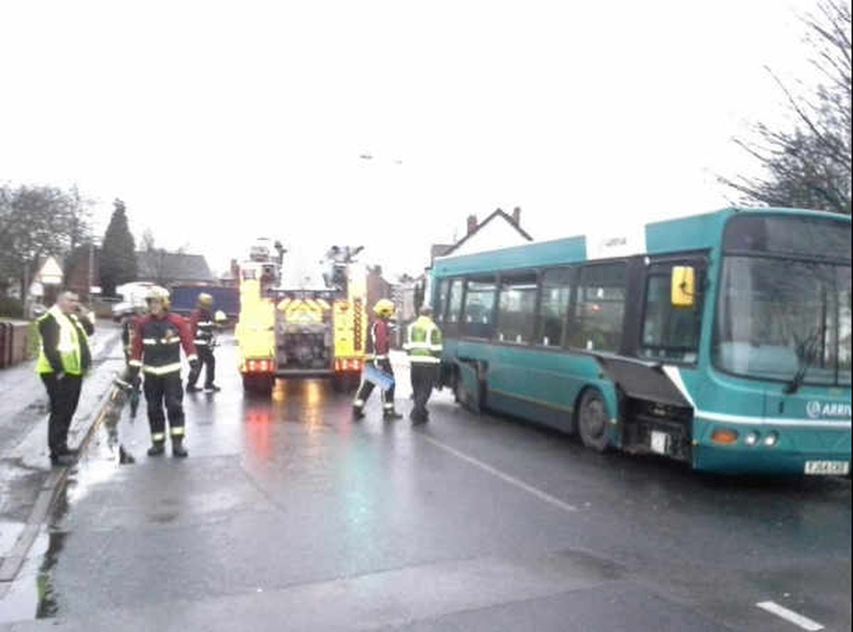 Firefighters attend the bus on Bilston Lane. Photo: Willenhall Fire Station