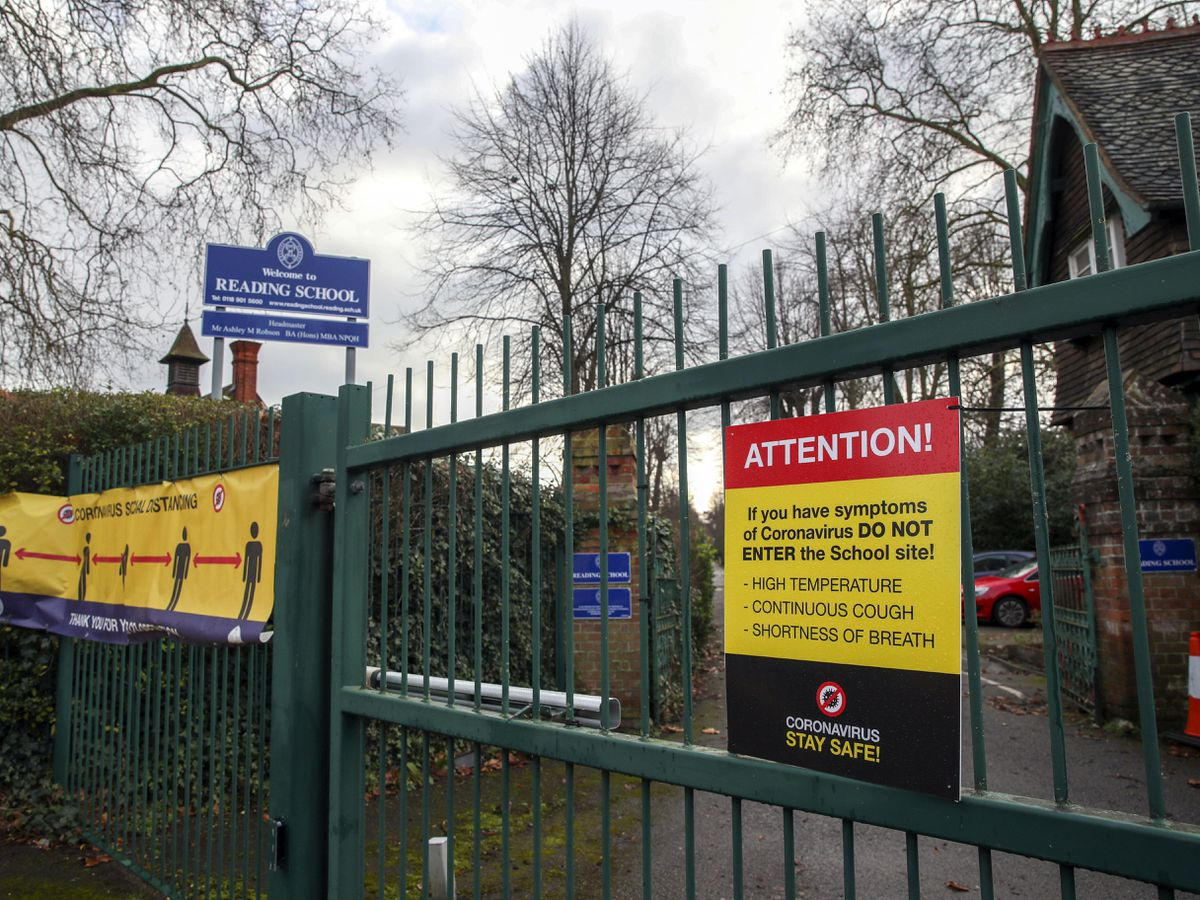 Coronavirus signs on the gates of Reading School