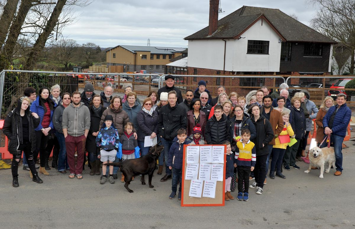 Campaigners on Springhill Lane with the nursery in the background