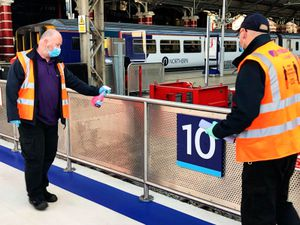 Handrails being cleaned at Liverpool Lime Street station