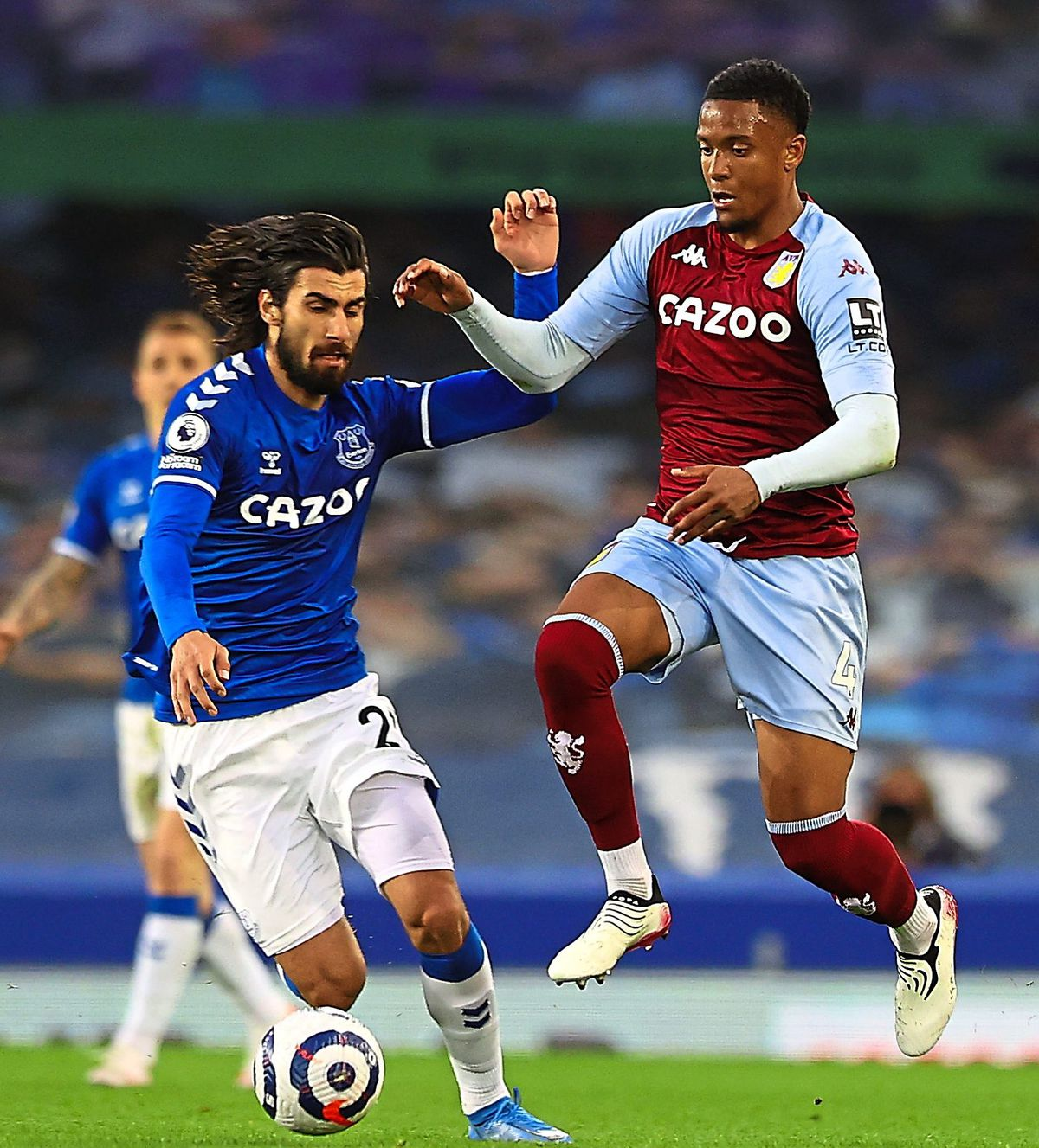 """Everton's Andre Gomes (left) and Aston Villa's Ezri Konsa battle for the ball during the Premier League match at Goodison Park, Liverpool. Issue date: Saturday May 1, 2021. PA Photo. See PA story SOCCER Everton. Photo credit should read: Naomi Baker/PA Wire. RESTRICTIONS: EDITORIAL USE ONLY No use with unauthorised audio, video, data, fixture lists, club/league logos or """"live"""" services. Online in-match use limited to 120 images, no video emulation. No use in betting, games or single club/league/player publications."""