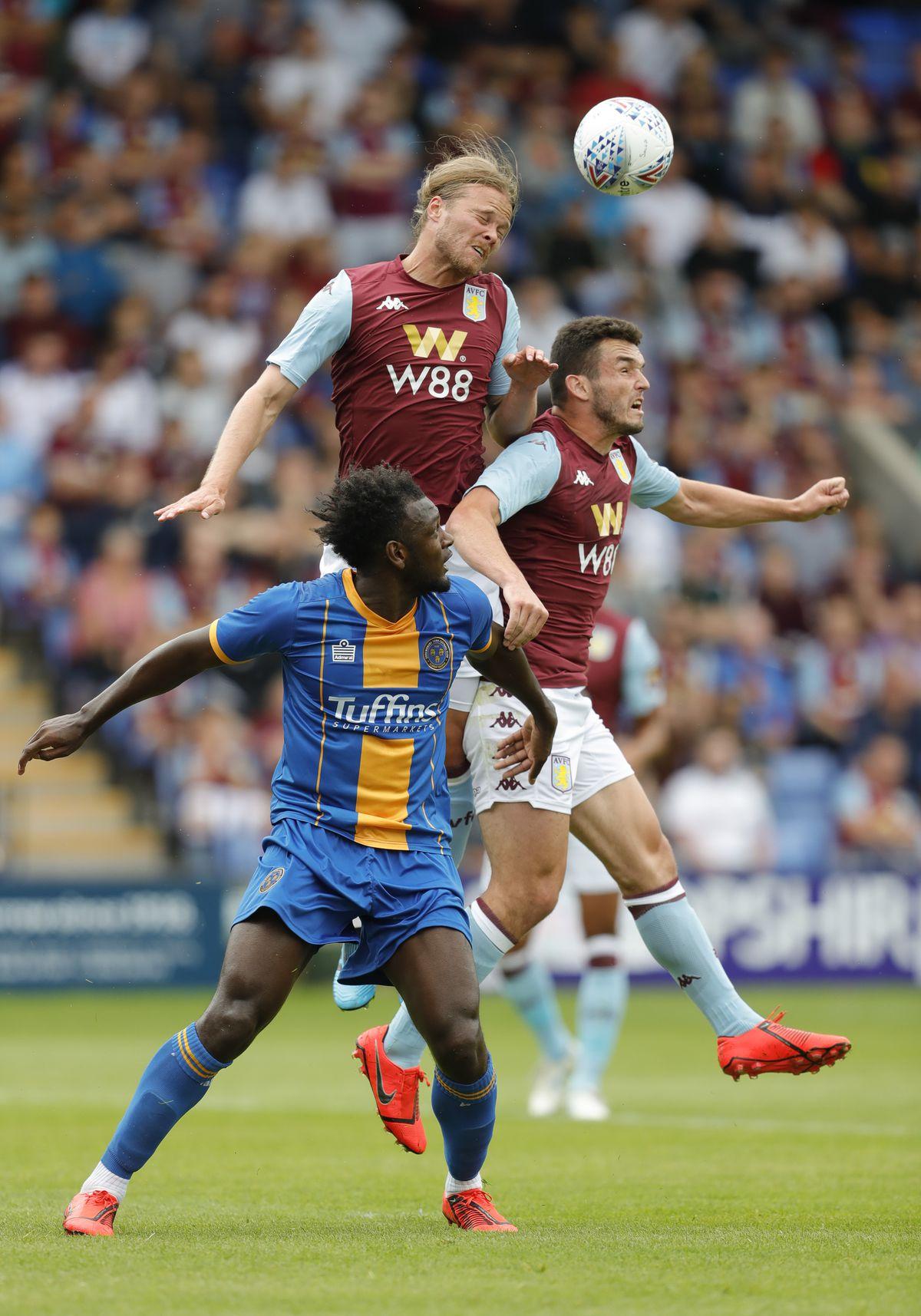 Aaron Pierre of Shrewsbury Town and Birkir Bjarnason and John McGinn of Aston Villa (AMA)