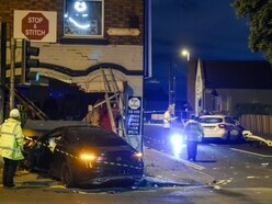 Driver critical as two Mercedes and shop wrecked in crash