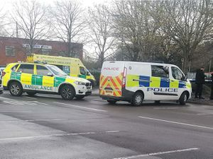 Emergency services at the scene where a newborn baby was found dead in the car park of Morrisons in Bilston