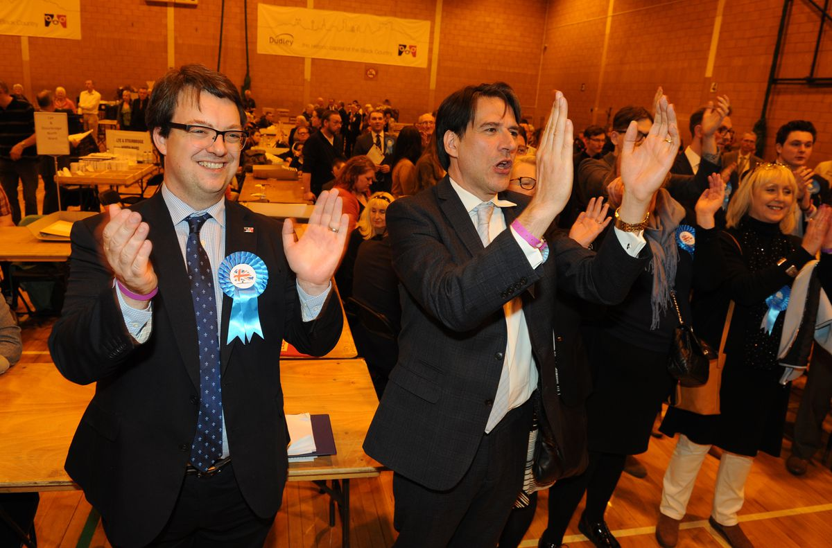 Jubilant Tory MPs Mike Wood and James Morris celebrate the result