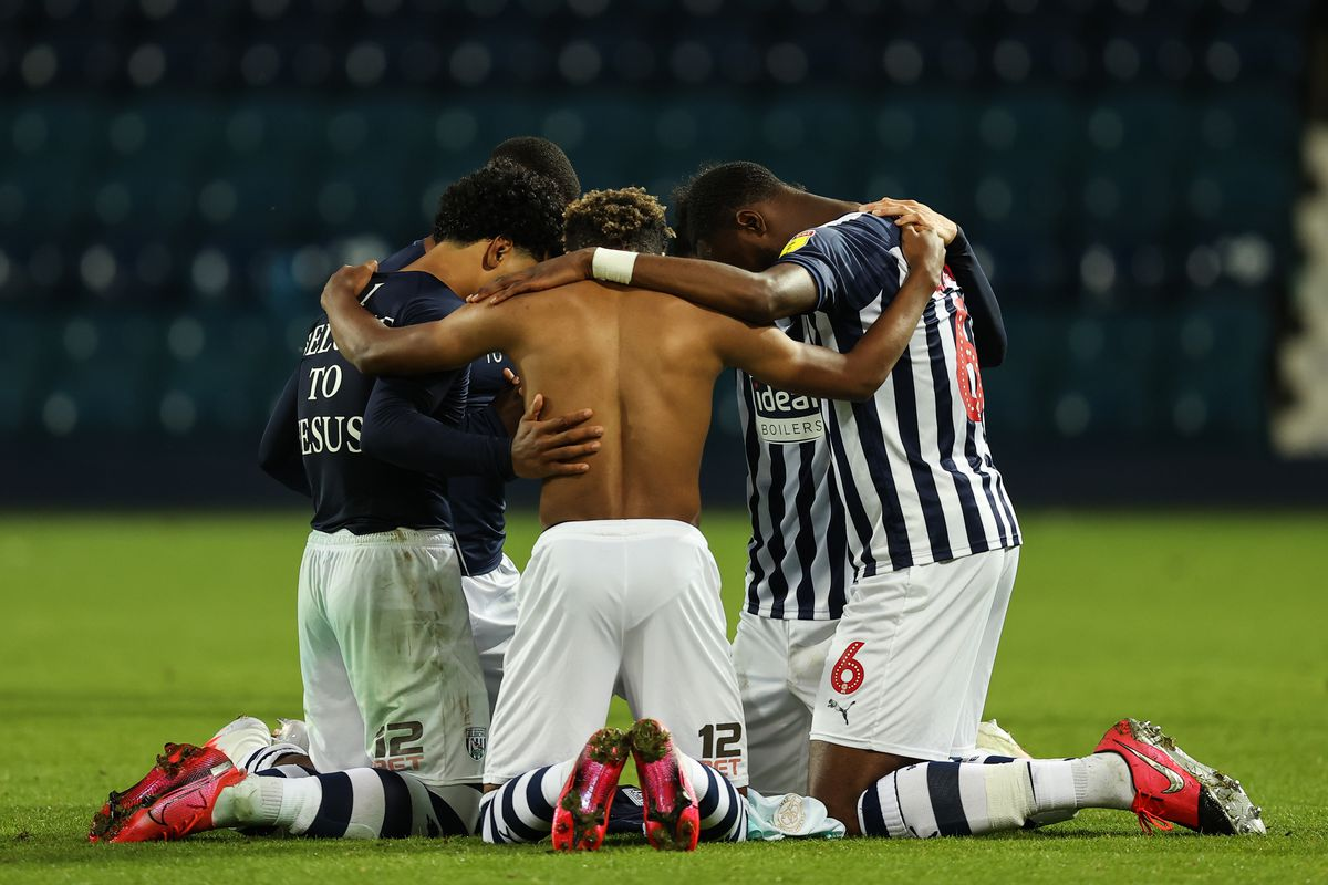 Players of West Bromwich Albion pray as they gain promotion on the final day. (AMA)