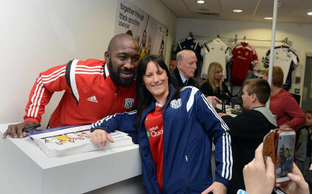 Darren Moore meets a fan at the opening