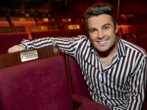 Joe McElderry with his seat at Wolverhampton Grand Theatre. Photo by Jonathan Hipkiss
