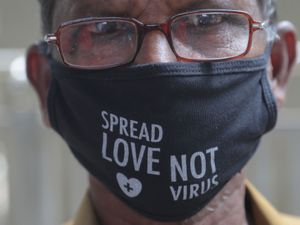 A man wears a face mask as a precaution against the coronavirus in Hyderabad, India, Saturday, Aug. 22, 2020. India has the third-highest caseload after the United States and Brazil, and the fourth-highest death toll in the world. (AP Photo/Mahesh Kumar A.).