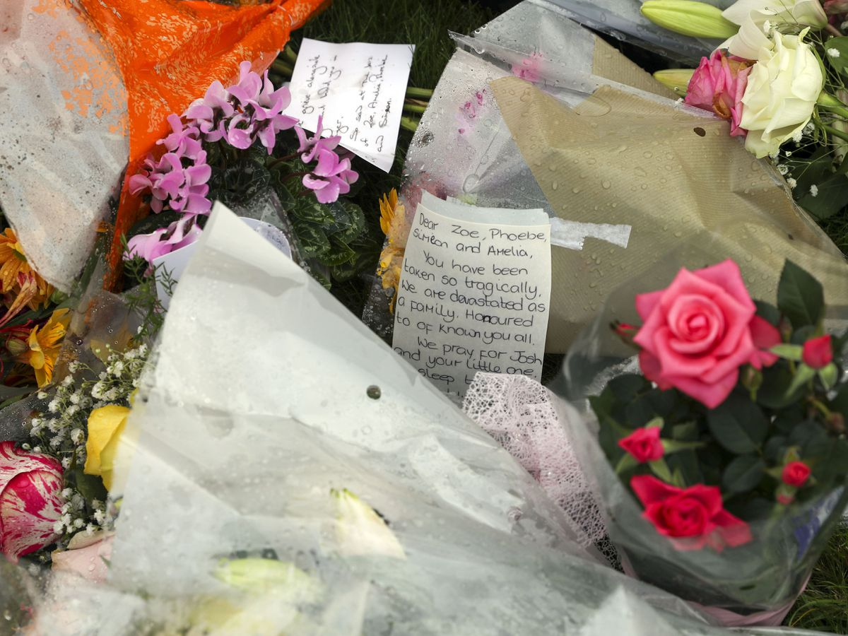 Floral tributes for Mrs Powell and her three children (Steve Parsons/PA)