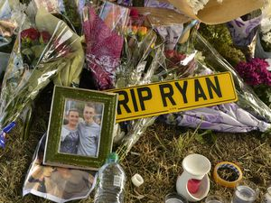 Tributes laid at the scene following the fatal crash in Upper Gornal