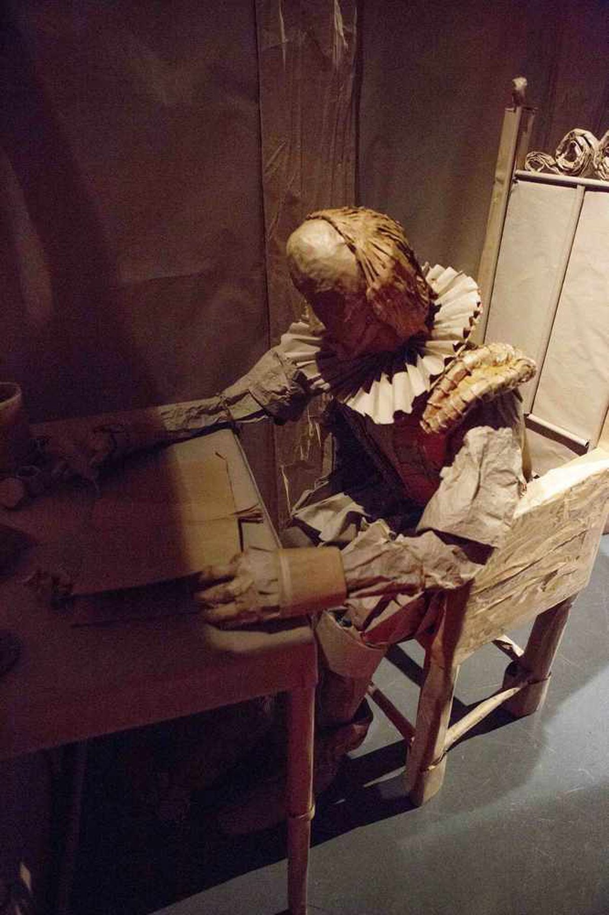 Shakespeare pens a play at his desk