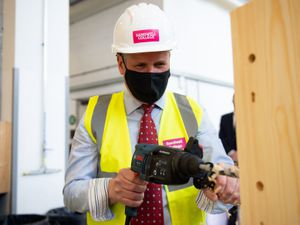 Labour leader Sir Keir Starmer uses a drill in a woodwork class during a visit to Sandwell College in the West Midlands