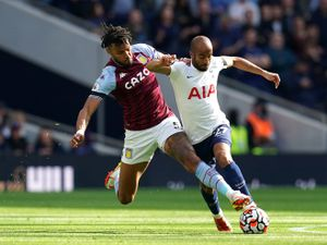 Tottenham Hotspur's Lucas Moura (right) is tackled by Aston Villa's Tyrone Mings