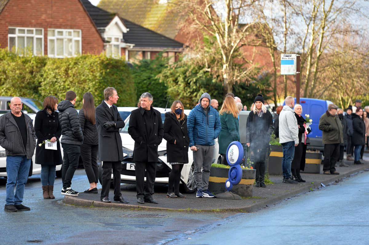 The funeral procession of milkman Kieron Moss makes it way through Wombourne