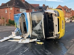 Driver injured after ice cream van flips over in crash