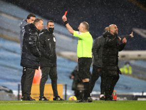 Match referee Jonathan Moss shows a red card to Aston Villa manager Dean Smith