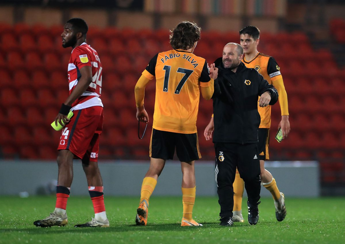Fabio Silva greets Under-23 head coach James Collins after the final whistle