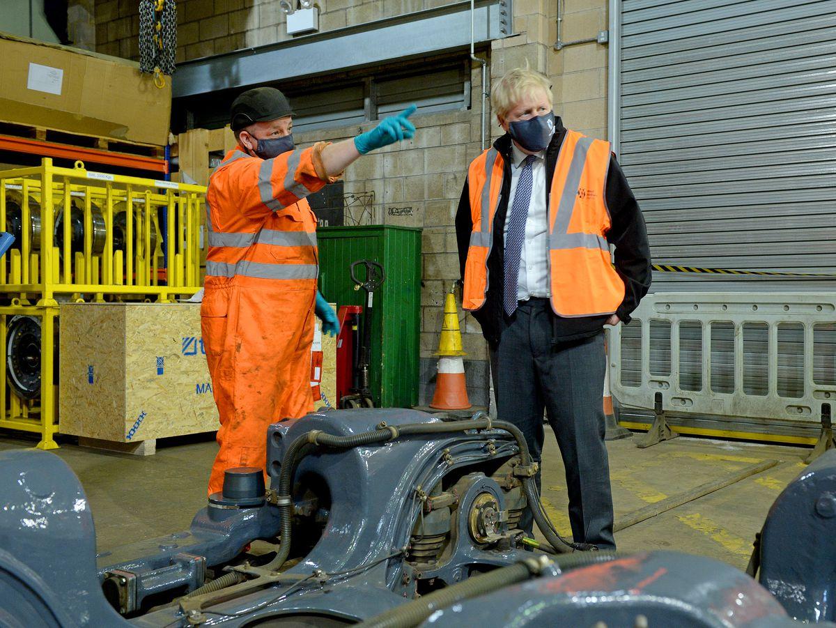 Boris Johnson chatting to technician Lee Gormston