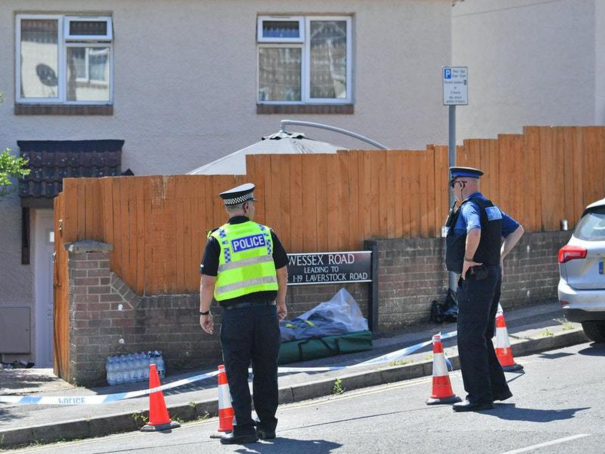 Police outside the property on Wessex Road (Ben Birchall/PA)